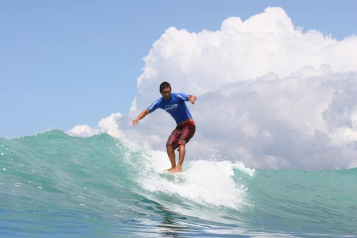 Male surfer riding a wave