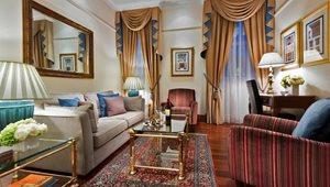 <h5>SUITES<br />Classic Master Suite Living Room at St. James' Court, a Taj Hotel</h5>