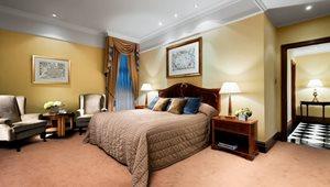 <h5>SUITES<br />Classic Master Suite Bedroom at St. James' Court, a Taj Hotel</h5>