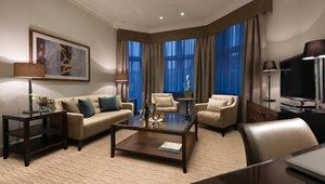 <h5>SUITES<br />Executive Junior Suite Living Room at St. James' Court, a Taj Hotel</h5>