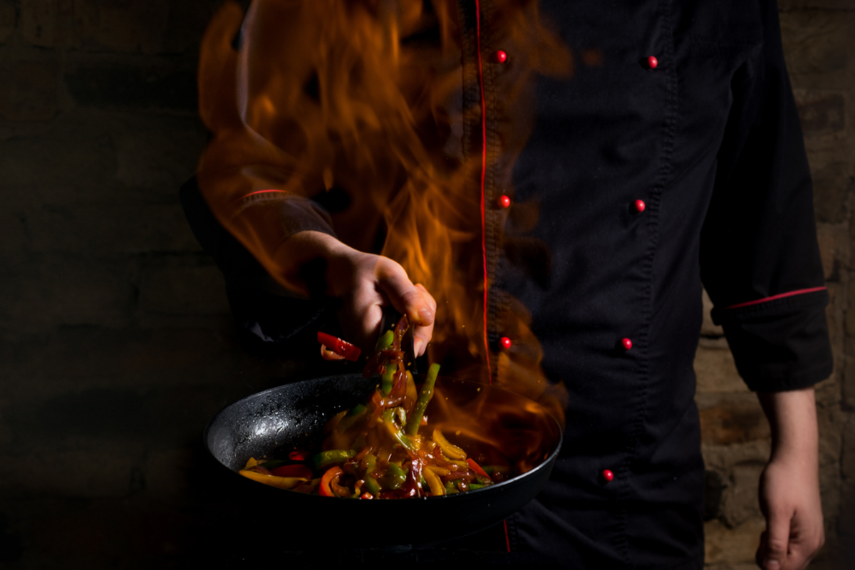 chef-cooking-on-flaming-pan