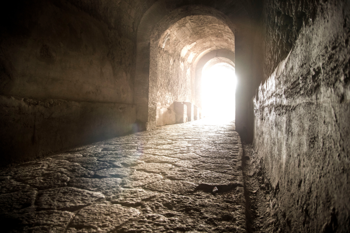 light-shining-through-stone-tunnel-opening-in-nyc-crypt-tour