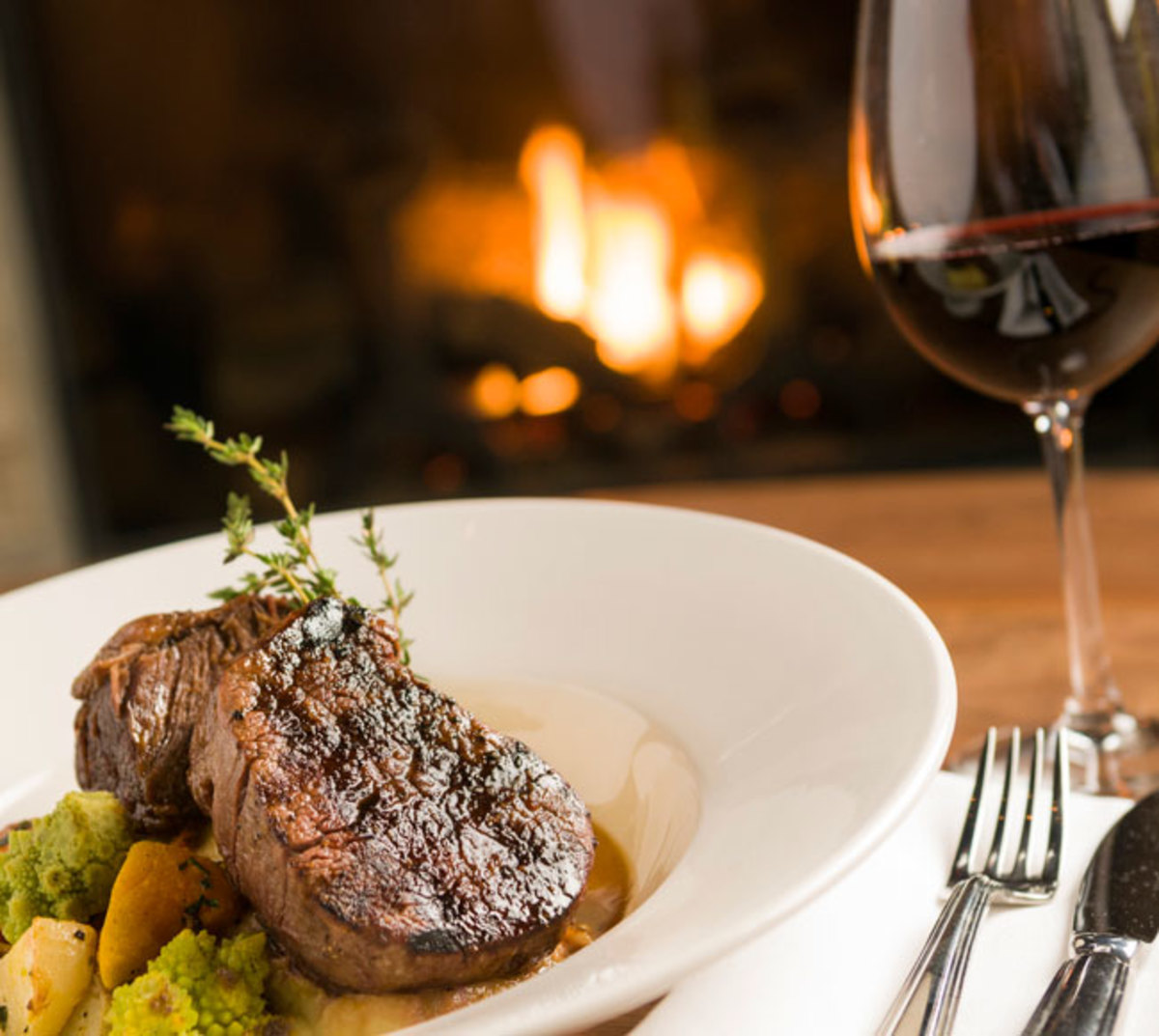 beef-and-red-wine-meal-in-front-of-fireplace
